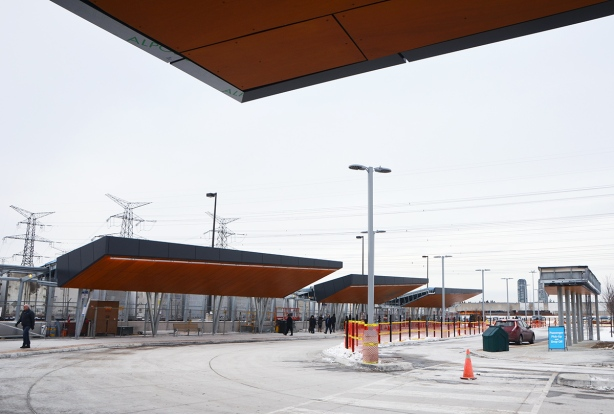 exterior at new Pioneer Village TTC subway station at Steeles Ave., new bus loops with wood overhangs, still under construction