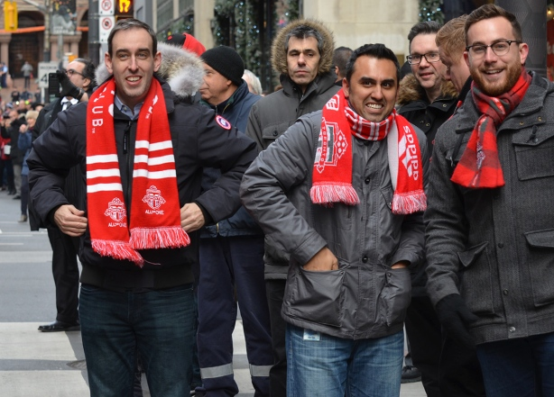 Toronto FC parade, people dressed in red and white, a group of men fans wearing red and white tfc team scarves