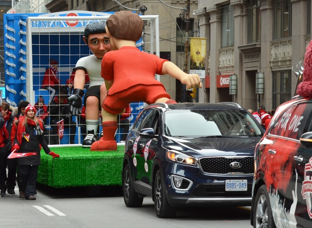float being pulled by a car in the tfc parade on Bay Street, December 2017