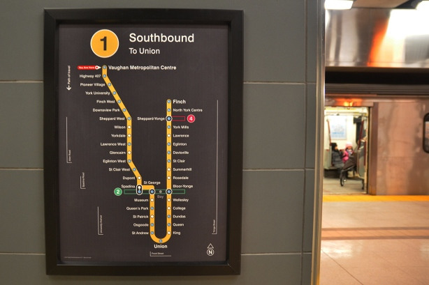 "map of line 1 of the TOronto subway system, with red ""you are here"" arrow at the top left hand side, for Vaughan subway station."