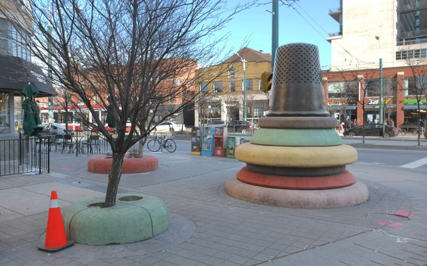 public art on the corner of Richmond and Spadina, giant thimble and giant buttons
