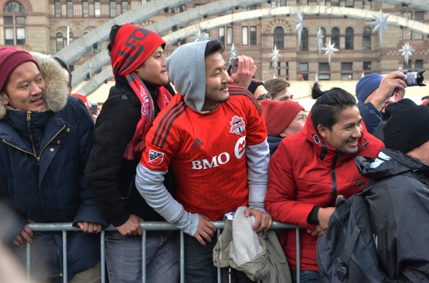 Toronto FC parade, people dressed in red and white,