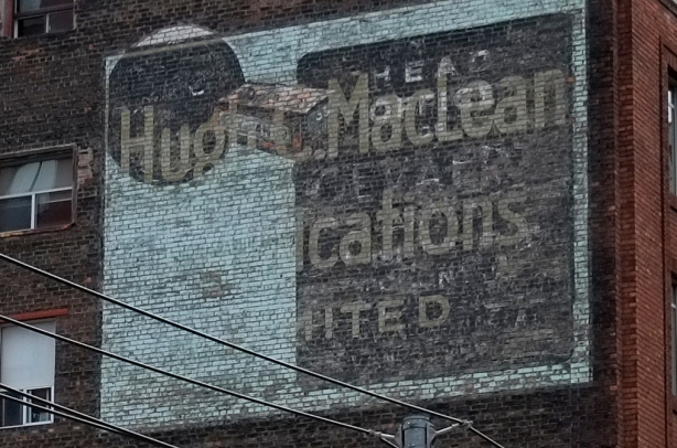 old ghost sign,two in one, one for Hugh C. Macleans publications and anther that is too faded to read