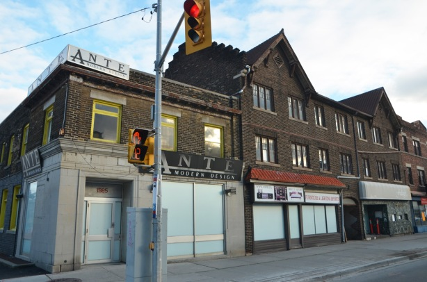 row of two storey store fronts, old brick building, that is now empty and about to be demolished, on Yonge Street
