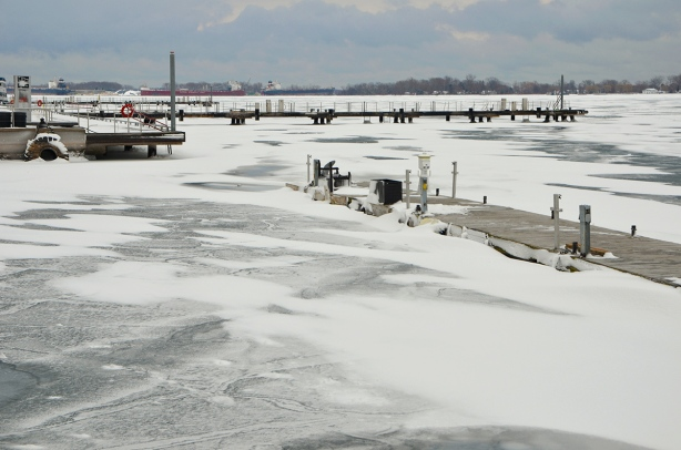 frozen harbour, Lake Ontario, with some snow covered docks