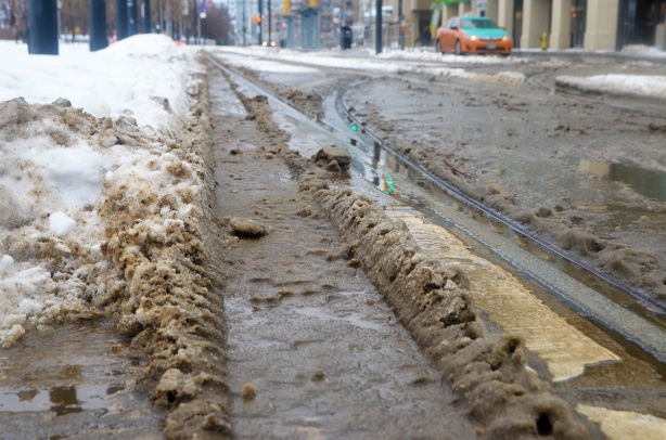 dirty slush along the streetcar tracks on Queens Quay
