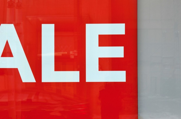 part of a red and white sale sign