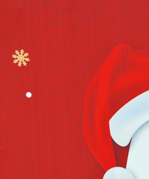 part of sign, red background, a gold snowflake and part of a red and white Santa hat