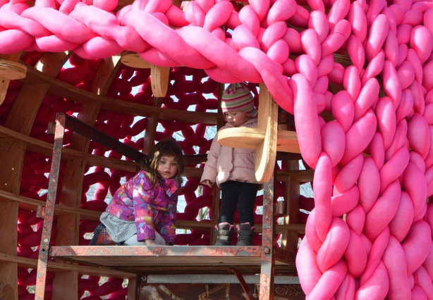 two little girls inside the large pink pussy hut warming station