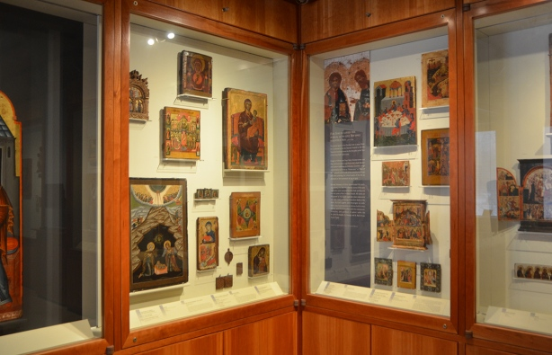 wall display cases in an art gallery, religious pieces on display, old, antiquities