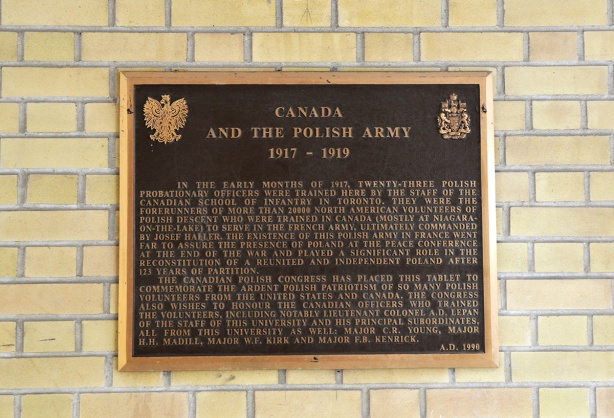 plaque on an exterior brick wall commemorating the role of the Polish Army