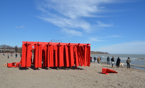 Obstacles, by Kien Pham, an art installation part of warming stations 2018 in Toronto, by Lake Ontario, consists of many large flaps of red fabric that you can walk between.