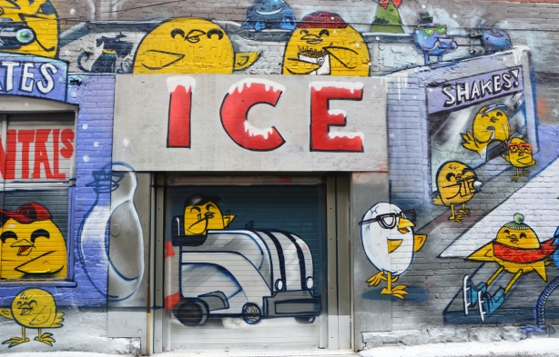 part of a winter themed uber5000 mural, yellow birdie about to drive a zamboni out of its garage, other yellow birdies looking on, a birdie that looks like a cracked egg.