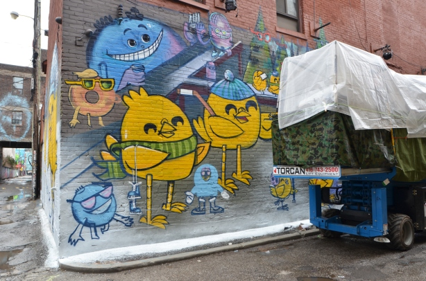 uber5000 mural in the process of being painted in graffiti alley