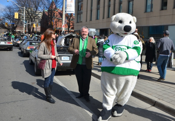 Carlton, the Maple Leafs hockey team mascot in a St. Pats jersey waiting for the parade to start, working the crowd.