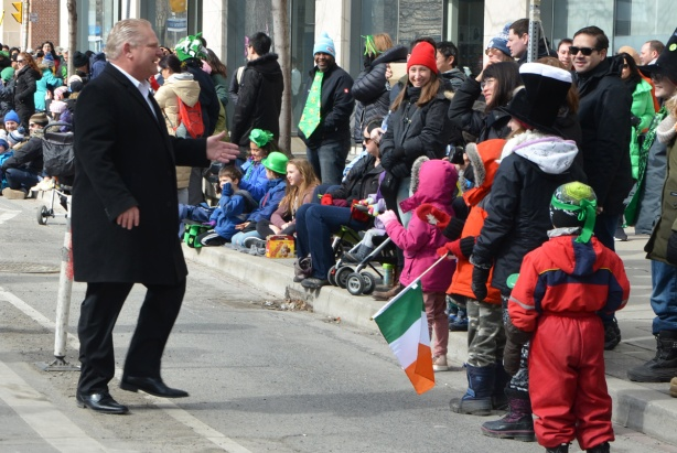 Doug Ford, St. Patricks day parade, wakls towaards the people on the sidewalk to shake hands, politician, politics,