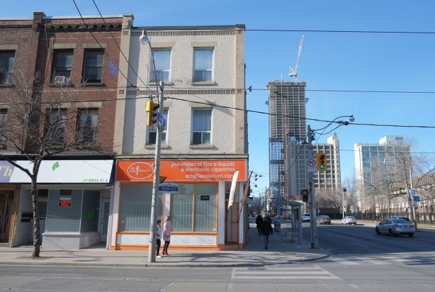 Queen and Jarvis intersection looking north to tall towers being built on Dundas
