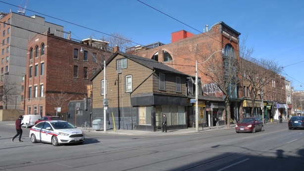 the northeast corner of Queen street east and Mutual street, with an empty building on the corner.