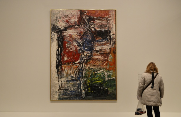 a woman with her back to the camera is looking at a large painting in an art gallery, AGO, Art gallery of Ontario,
