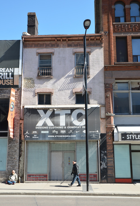 empty two storey building, once was X T C clothing store