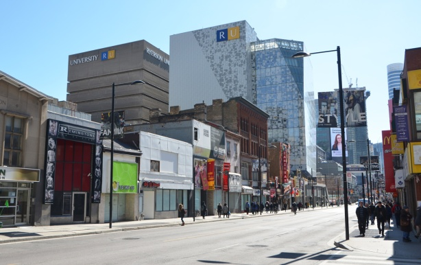 yonge street, between gerrard and dundas, most storefronts are closed and boarded up waiting for redevelopment of that stretch