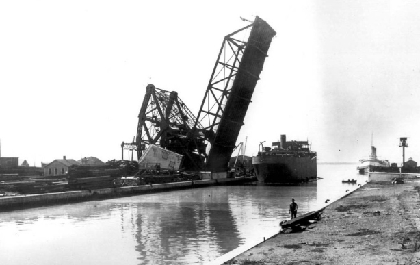 photo from the Toronto Archives of the liftbridge at Cherry Street, open position, black and white photo taken about 1915, found on Wikipedia.
