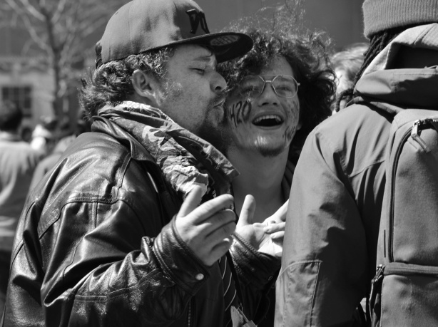 a black and white photo of two men at a 420 event.