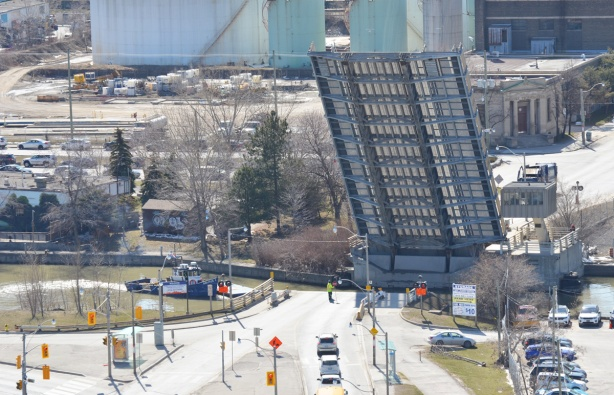 lift bridge is up so a boat can pass under