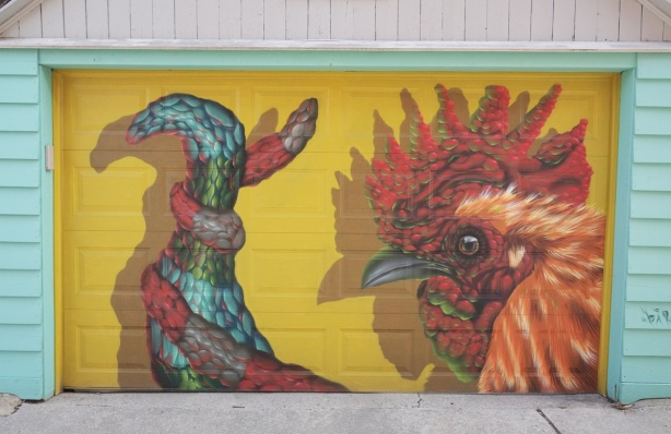 birdo mural of a rooster on a garage door