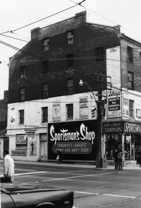 old black and white photo of the Sportsmans Shop at 150 King East in Toronto, three storey brick building