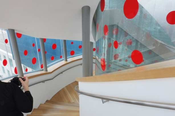 the windows on the staircase that runs behind the Art Gallery of Ontario back wall, from 5th to 4th floor, are covered with big red dots in honour of the exhibit by Yayui Kusama