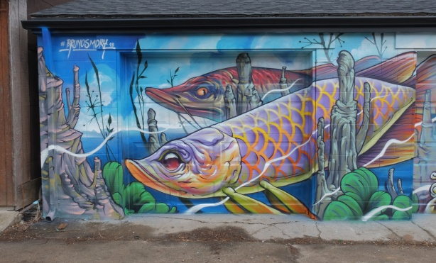 mural by Bruno Smoky, part of it, two large fish swimming under water.