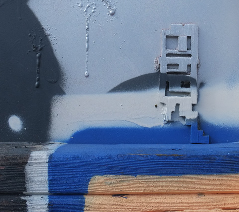 stikman on a white and blue wall