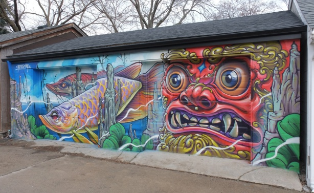 mural on a double garage door, man's face, fish swimming underwater, by Bruno Smoky 2018