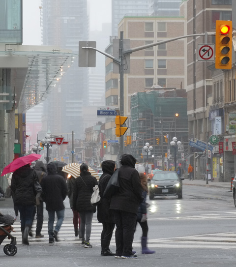 people walking in the rain, downtown Toronto