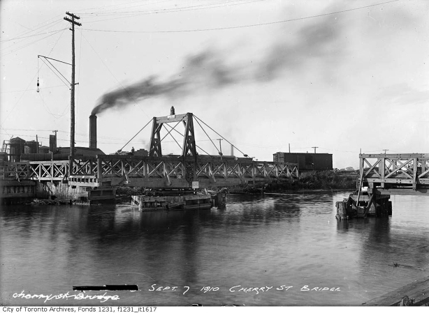 vintage photo, black and white, 1910 of wood swing bridge in open position, some boats around, Keating Channel, Cherry Street, Toronto,