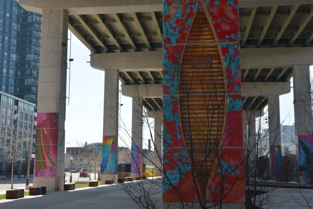 at the Bentway, Dana Claxton's 'Forest of Canoes' art installation of pictures of canoes on the concrete supports of the Gardiner Expressway - cedar strip canoe