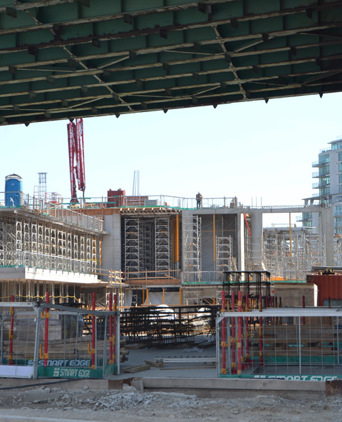 construction site that is partially covered by the Gardiner Expressway