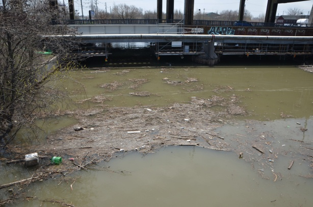 bridge over the Don River, grey, flotsam in the river,