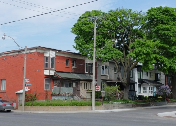two storey row houses on McGee Ave, lots of large tress, house painted orange,