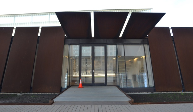 entrance to Fort York visitors centre, rusted metal panels on exterior walls and as covering over doorway