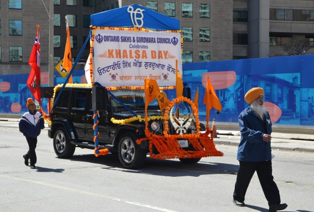 black jeep decorated as a float in khalsa day parade in toronto