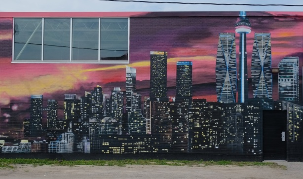 mural of Toronto at night with lots of lights, CN Tower,