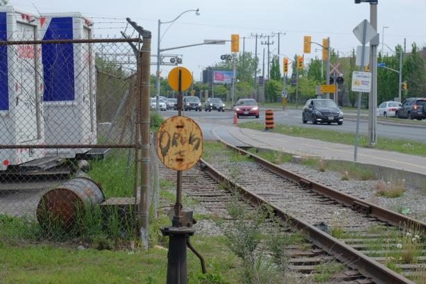 railway tracks running parallel to road, traffic,