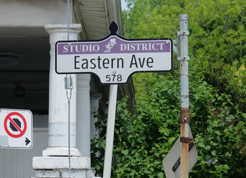Toronto street sign that says Studio District, Eastern Avenue