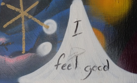 close up of street art on a wall, that someone has written in black marker, I feel good.