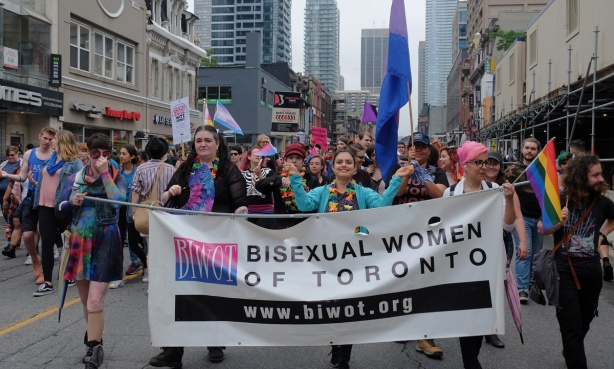dyke march 2018 - group of women carrying a banner that says bisexual women of Toronto