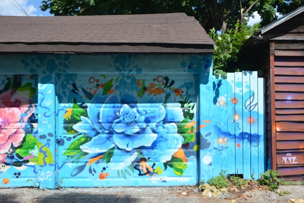 blue flower painted on a garage door, by @chrispperez