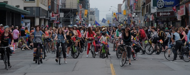 dykes on bikes lined up across Yonge street in the middle of the parade, Dyke March 2018