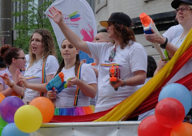 three women with super soakers (water guns) on a float in the pride parade, ONA, ontario nurses association